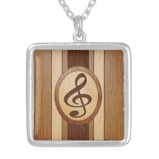 Faux wood inlay treble clef necklace